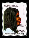 Traditional hairstyle, International Women`s Day serie, circa 1989. MOSCOW, RUSSIA - DECEMBER 21, 2017: A stamp printed in Guinea-Bissau shows Traditional Royalty Free Stock Images