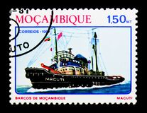 Tugboat `Macuti`, Ships of Mozambique serie, circa 1981. MOSCOW, RUSSIA - DECEMBER 21, 2017: A stamp printed in Mozambique shows Tugboat `Macuti`, Ships of Stock Photo