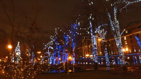 MOSCOW, RUSSIA - DECEMBER 28, 2015: The streets of city on eve of Christmas. Set of holiday lights, garlands, stock video