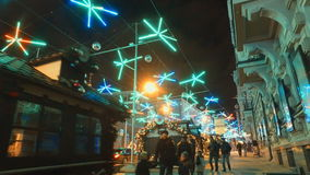 MOSCOW, RUSSIA - DECEMBER 24, 2015: The streets of city on eve of Christmas. Set of holiday lights, garlands, stock footage
