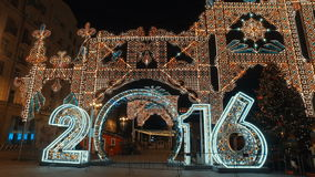 MOSCOW, RUSSIA - DECEMBER 24, 2015: The streets of city on eve of Christmas. Set of holiday lights, garlands, stock video footage