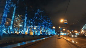 MOSCOW, RUSSIA - DECEMBER 24, 2015: The streets of city on eve of Christmas. Set of holiday lights, garlands, stock video