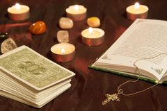 Tarot cards with book and cross. Royalty Free Stock Image