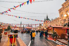 MOSCOW, RUSSIA - DECEMBER 23, 2016: Tourists on red Square in Moscow on the eve of New year. At the shopping stalls Stock Photo