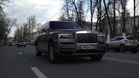 Moscow, Russia - 13 03 2020: Expensive status car moves forward along the street. Gray Rolls Royce Cullinan rides on