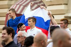 Fans of football on the Moscow street with Russian flag. World cup 2018. People wearing colorful clothes. royalty free stock images