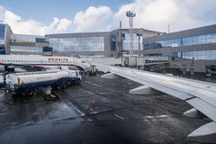 Moscow Russia 28 of Feb. 2016: Airplane under loading in an Domodedovo airport Royalty Free Stock Photo