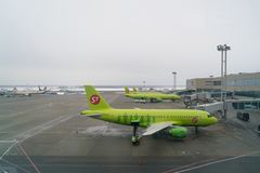 Moscow, Russia - February 04, 2017: Airplane of S7 airlines preparing for flight in airport. Moscow, Russia - February 04, 2017: Airplane of S7 airlines Stock Photo
