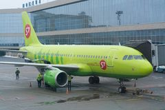 Moscow, Russia - February 04, 2017: Airplane of S7 airlines preparing for flight in airport. Moscow, Russia - February 04, 2017: Airplane of S7 airlines Royalty Free Stock Image