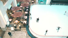 MOSCOW, RUSSIA - FEBRUARY, 27, 2017. Cafe and ice skating rink in modern shopping mall Vegas. MOSCOW, RUSSIA - FEBRUARY, 27, 2017. Cafe and ice skating rink in Royalty Free Stock Images