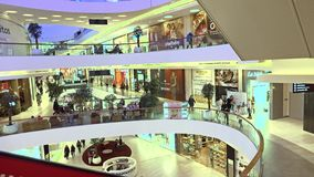 MOSCOW, RUSSIA - FEBRUARY, 28, 2017. Cafes and stores of modern shopping mall Metropolis. 4K shot stock footage