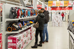 Moscow, Russia - February 02. 2016. Customers choose a vacuum cleaner in Eldorado, large chain stores selling Royalty Free Stock Photos