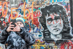 Moscow, Russia - February 21.2016. Fans are photographed against a wall dedicated to the memory of  cult singer Viktor Tsoi Royalty Free Stock Photography