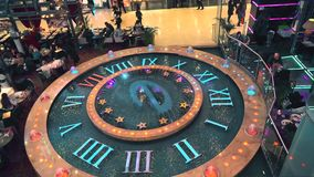 MOSCOW, RUSSIA - FEBRUARY, 28, 2017. Fountain clock and cafes at shopping mall. 4K shot stock footage