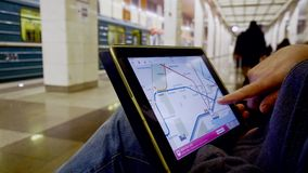 Man in underground examines the subway map using the tablet. Moscow, Russia - February 11, 2018: Man in underground examines the subway map using the tablet stock video footage