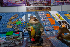 Moscow, Russia - February 25, 2017: Mascot-fisherman on a showcase with fishing gears Stock Images