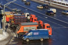 Moscow, Russia - February 14, 2018: Municipal special trucks for cleaning city streets on a parking lot in sunny winter day Stock Photos