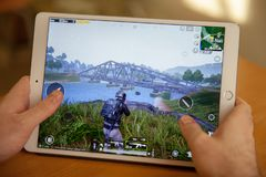 Moscow, Russia - February 8, 2019. Online game PUBG mobile on the tablet. royalty free stock photo