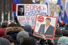 People carrying russian flags and banners on Nemtsov memory march in Moscow. Moscow, Russia - February 24, 2019. People carrying russian flags and banners with stock photo