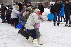 People playing Tug Of War at Russian national festival `Shrove` in park Gorkogo in Moscow royalty free stock images