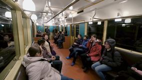 People are riding in the subway. Moscow, Russia - February 11, 2018: People are riding in the subway stock video footage