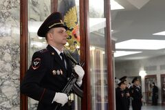 A policeman on duty at the banner of the Ministry of Internal Affairs of Russia