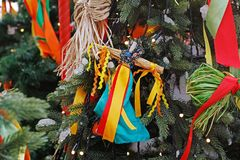 Moscow, Russia - February 08, 2018: Russian Shrovetide doll in traditional colorful dress hanging on Christmas tree at Russian stock image