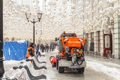 MOSCOW, RUSSIA - FEBRUARY 13,2019: Snow plow cleaning snow from city road stock images