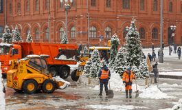 MOSCOW, RUSSIA - FEBRUARY 13,2019: Snow plow cleaning snow from city road royalty free stock photography