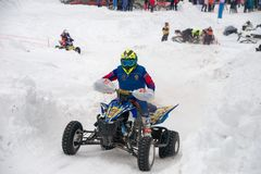 On a quad over snow stock image