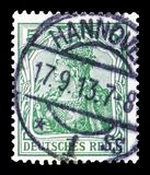 Germania with imperial crown, inscription 'REICHSPOST ', serie, circa 1900. MOSCOW, RUSSIA - FEBRUARY 10, 2019: A stamp printed in German Realm shows Germania royalty free stock image