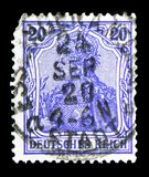 Germania with imperial crown, inscription 'REICHSPOST ', serie, circa 1900. MOSCOW, RUSSIA - FEBRUARY 10, 2019: A stamp printed in GermanRealm shows Germania royalty free stock photography