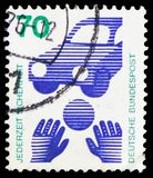 Road safety - ball in front of a car, Prevent accidents serie, circa 1971. MOSCOW, RUSSIA - FEBRUARY 20, 2019: A stamp printed in Germany, Federal Republic royalty free stock images