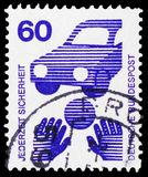Road safety - ball in front of a car, Prevent accidents serie, circa 1971. MOSCOW, RUSSIA - FEBRUARY 20, 2019: A stamp printed in Germany, Federal Republic stock image