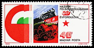 Building the railroads, Hungary`s Liberation from Fascism, 30th anniversary serie, circa 1975. MOSCOW, RUSSIA - FEBRUARY 22, 2019: A stamp printed in Hungary royalty free stock photo