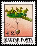 Pecking chickens, Antique Toys serie, circa 1988. MOSCOW, RUSSIA - FEBRUARY 22, 2019: A stamp printed in Hungary shows Pecking chickens, Antique Toys serie stock photo