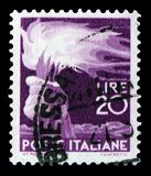 Hand holding a torch, 20 Lires, Democracy serie, circa 1945. MOSCOW, RUSSIA - FEBRUARY 10, 2019: A stamp printed in Italy shows Hand holding a torch, 20 Lires stock image