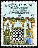 60st Anniversary of World Chess Federation, Chess serie, circa 1984. MOSCOW, RUSSIA - FEBRUARY 9, 2019: A stamp printed in Laos devoted to 60st Anniversary of stock image