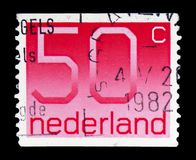 Numeral, 50 Dutch cents, Figure type 'Crouwel ' serie, circa 1980. MOSCOW, RUSSIA - FEBRUARY 10, 2019: A stamp printed in Netherlands shows Numeral, 50 Dutch stock image