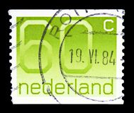 Numeral, 60 Dutch cents, Figure type 'Crouwel ' serie, circa 1981. MOSCOW, RUSSIA - FEBRUARY 10, 2019: A stamp printed in Netherlands shows Numeral, 60 Dutch royalty free stock photos