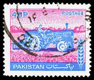 Tractor, Agriculture serie, circa 1978. MOSCOW, RUSSIA - FEBRUARY 21, 2019: A stamp printed in Pakistan shows Tractor, Agriculture serie, circa 1978 stock photography