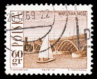 Poniatowski Bridge, Warsaw, and sailboat, Tourist attractions serie, circa 1966. MOSCOW, RUSSIA - FEBRUARY 10, 2019: A stamp printed in Poland shows Poniatowski stock images