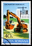 Hydraulic excavator, Industrial Development serie, circa 1978. MOSCOW, RUSSIA - FEBRUARY 10, 2019: A stamp printed in Romania shows Hydraulic excavator stock photos