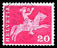 Postrider 19th century, Postal history motives and monuments serie, circa 1960. MOSCOW, RUSSIA - FEBRUARY 10, 2019: A stamp printed in Switzerland shows stock photos