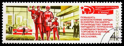 Family in shopping center, Resolutions of 24th Communist Party Congress serie, circa 1971. MOSCOW, RUSSIA - FEBRUARY 20, 2019: A stamp printed in USSR (Russia) stock photo