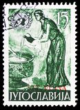 Girl with water jug, United Nations serie, circa 1953. MOSCOW, RUSSIA - FEBRUARY 10, 2019: A stamp printed in Yugoslavia shows Girl with water jug, United royalty free stock photography