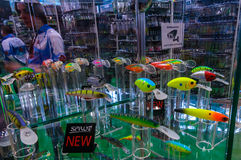 Moscow, Russia - February 25, 2017: Stand with samples of the newest fishing lures and wobblers on special exhibition stock images