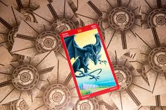 Tarot card Ten of Swords. Dragon tarot deck. Esoteric background. Moscow, Russia - February 18, 2018: Tarot card Ten of Swords. Dragon tarot deck. Esoteric Stock Photos