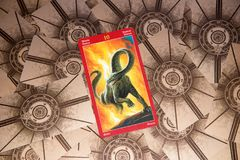 Tarot card Ten of Wands. Dragon tarot deck. Esoteric background. Moscow, Russia - February 18, 2018: Tarot card Ten of Wands. Dragon tarot deck. Esoteric Stock Images