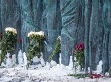 Moscow - Russia, February 25th 2018. Flowers near the monument devoted to victims of Stalin's repressions Stock Image